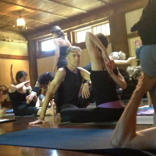 Discussing shoulder mechanics with Richard during a Mysore class at the Advanced Teacher's Intensive at Upaya Zen Center in 2013. Photo by Laura Yasuda